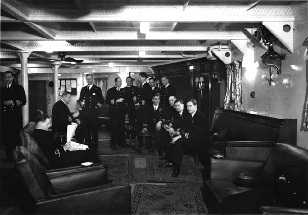 Click image for larger version.  Name:01.00. 16 Officers gathered in the wardroom anteroom of the battleship HMS King George V, 1941.jpg Views:5 Size:188.2 KB ID:2150554