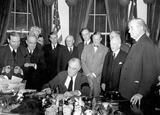 Click image for larger version.  Name:01.00. 3 5 3 Roosevelt signs declaration of war japan at the White House.jpg Views:3 Size:102.4 KB ID:2138346