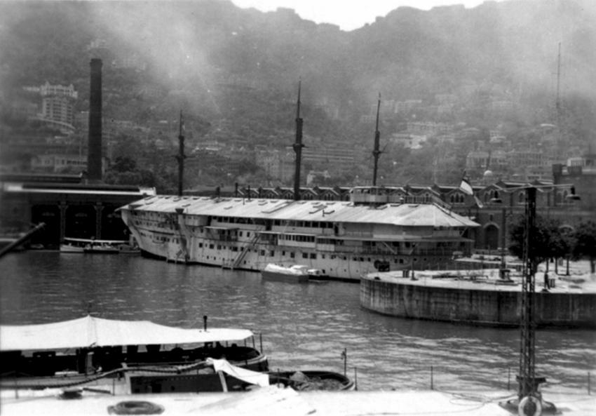 Click image for larger version.  Name:01.00. 53 04 8 19 Hongkong HMS Tamar The hulk of  the former Troop Ship H.M.S. TAMAR 1941 3.jpg Views:3 Size:233.3 KB ID:2159202