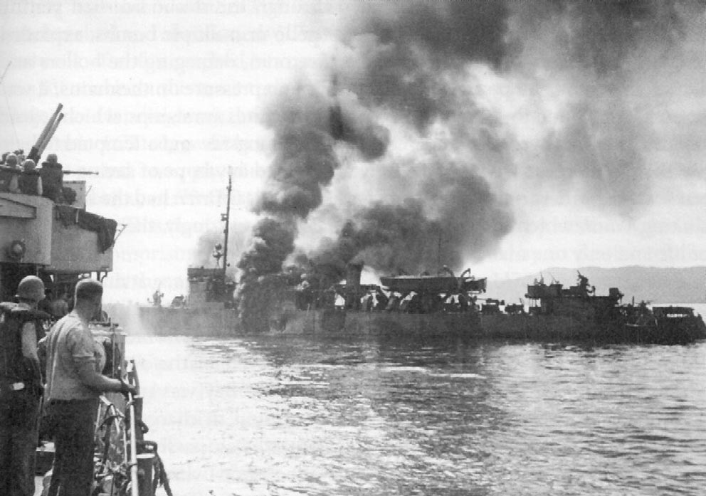 Click image for larger version.  Name:1.1. 2 2 4 40 USS Ward (APD-16), after being hit by a kamikaze 1.jpg Views:1 Size:113.1 KB ID:3681673