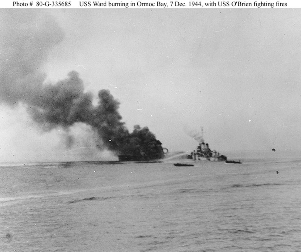 Click image for larger version.  Name:1.1. 2 2 4 40 USS Ward (APD-16) burning in Ormoc Bay, Leyte.jpg Views:1 Size:110.1 KB ID:3681671