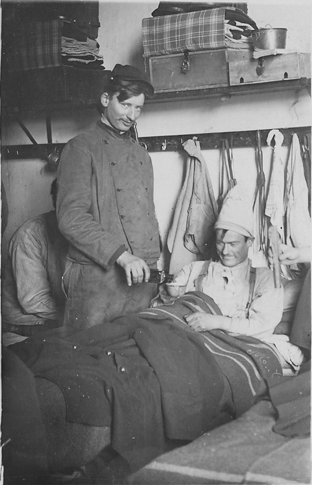 Click image for larger version.  Name:2.3.1. 3 3 WW1 absinthe 1 wounded WW1 French soldier treated by fellow combatant with a bottle o.jpg Views:1 Size:174.7 KB ID:3653555
