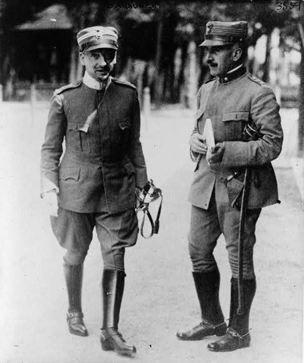 Click image for larger version.  Name:2.3.2. 1 15 5 Irredenta patriotic poet Gabriele D'Annunzio, facing the camera, walks past anothe.jpg Views:1 Size:134.8 KB ID:3654977