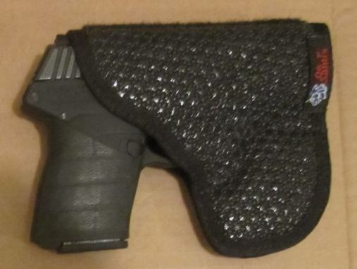 De Santis gunhide superfly holster with  PF9  with velco flap  removed 3-19-2012.jpg