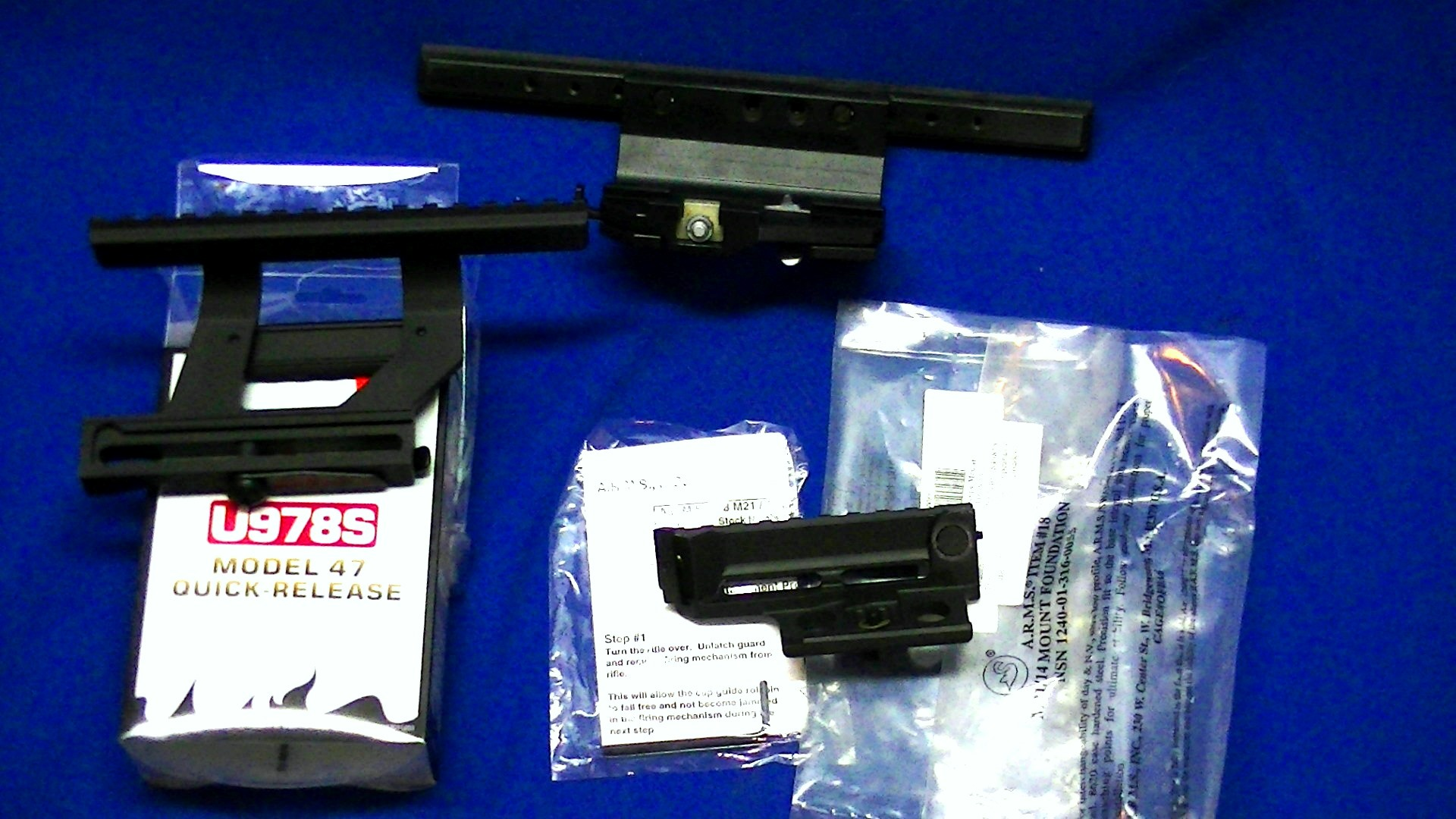 Pile 'o scope mounts and magazines ak - m1a - ruger - glock
